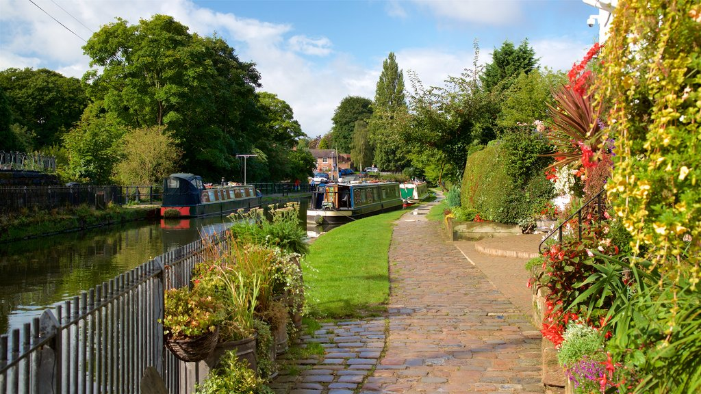 Lymm showing wildflowers, a garden and a river or creek