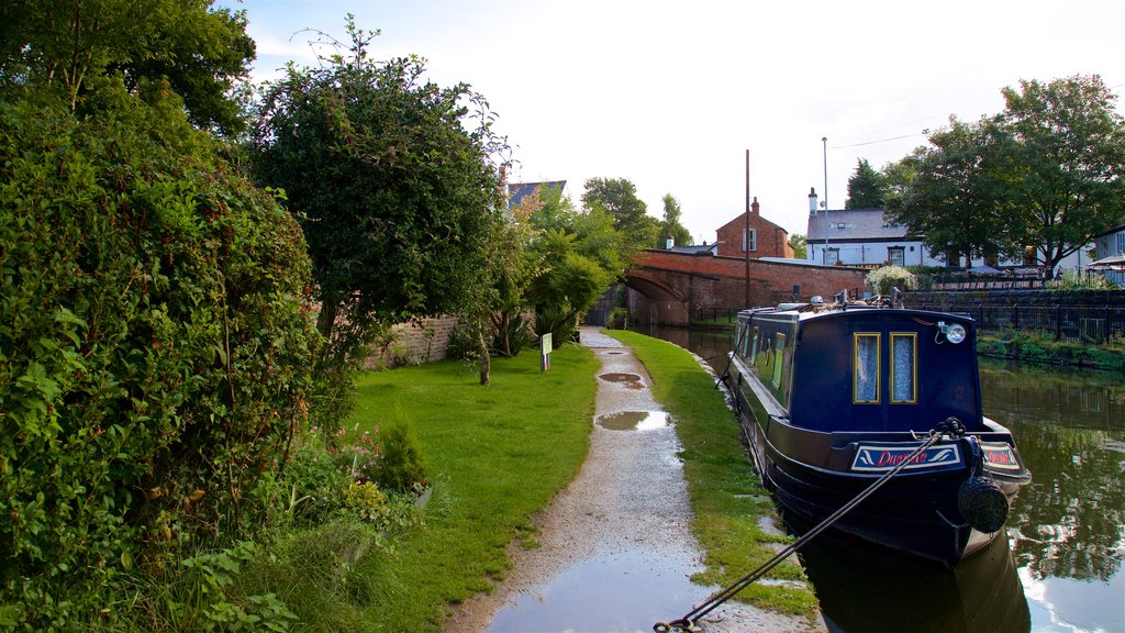 Lymm showing a garden and a river or creek