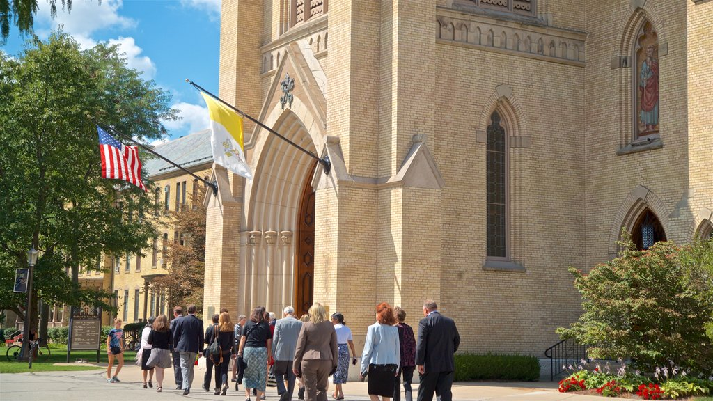 Basilica of the Sacred Heart featuring heritage architecture and a church or cathedral as well as a small group of people