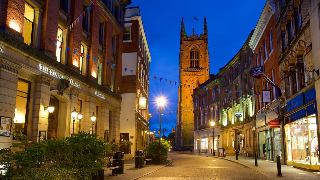 Derby Cathedral which includes a city, night scenes and heritage architecture