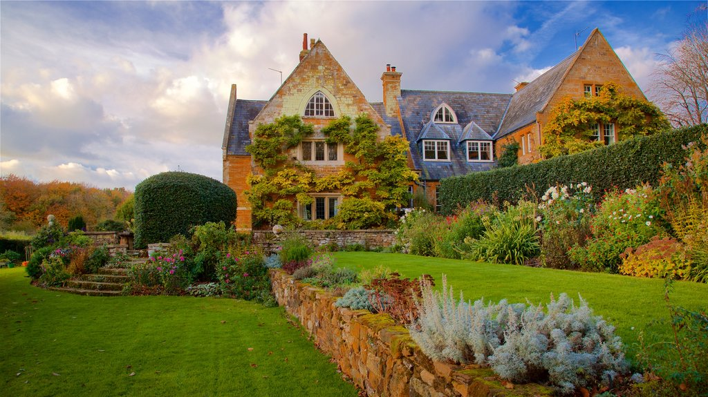 Coton Manor Gardens featuring a park, wildflowers and a house