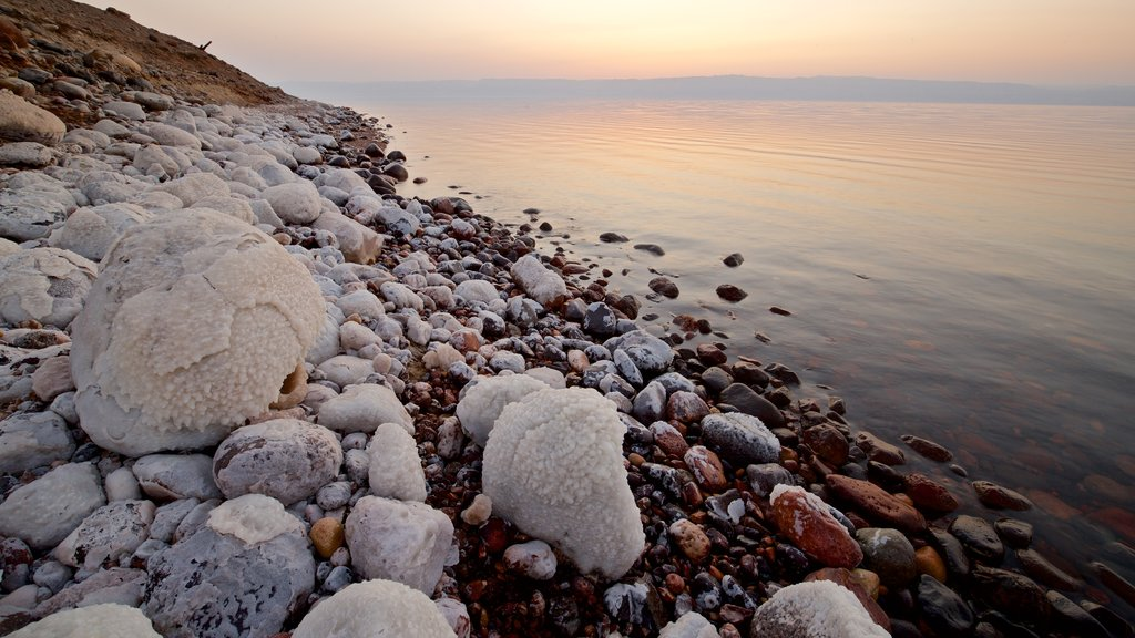 Mujib Nature Reserve featuring a pebble beach, a sunset and general coastal views