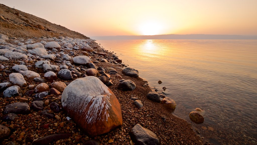 Mujib Nature Reserve which includes a pebble beach, a sunset and general coastal views