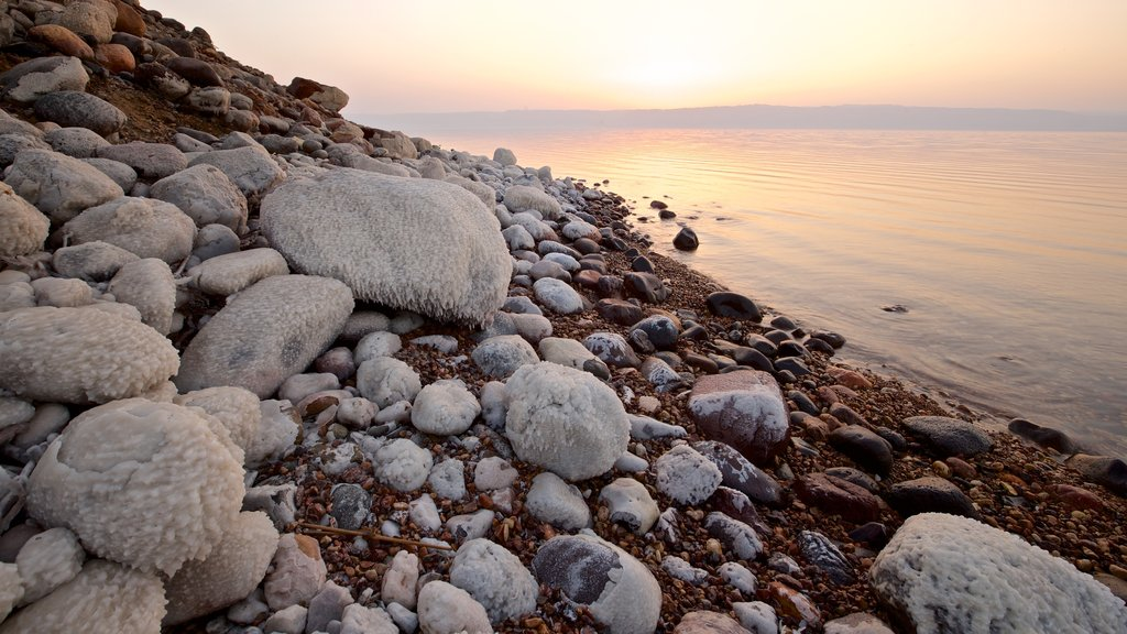 Mujib Nature Reserve which includes a pebble beach, general coastal views and a sunset