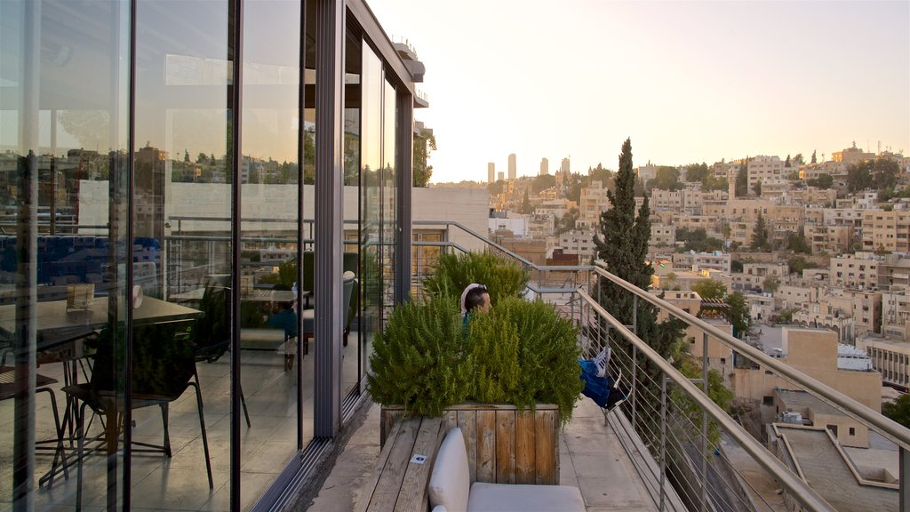 Amman which includes a city, a sunset and landscape views