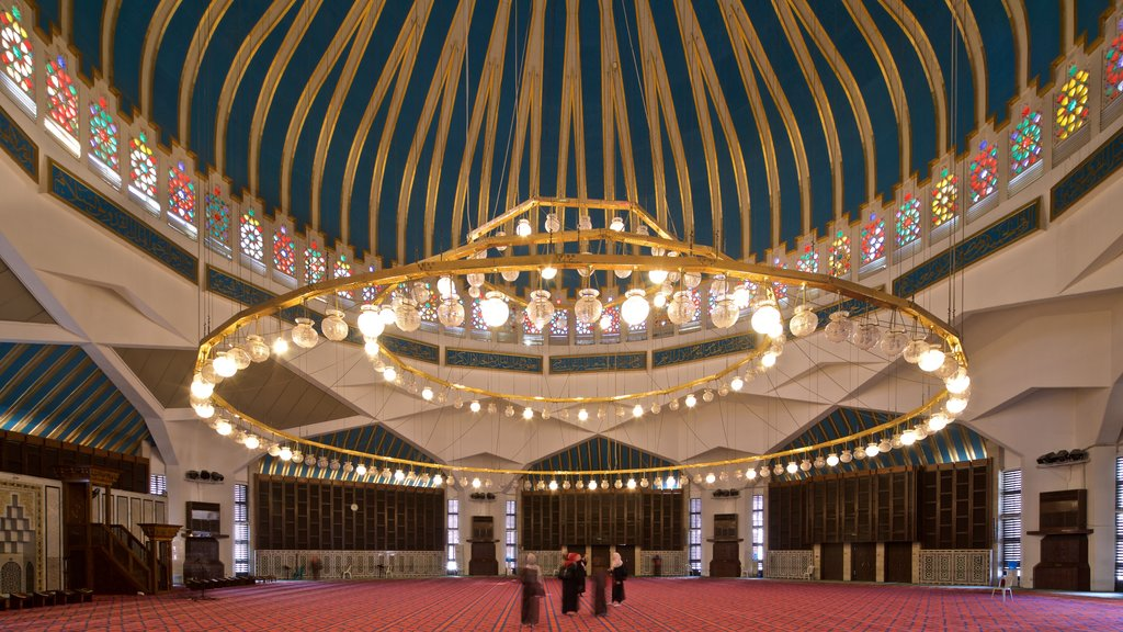 King Abdullah I Mosque featuring heritage elements and interior views as well as a small group of people