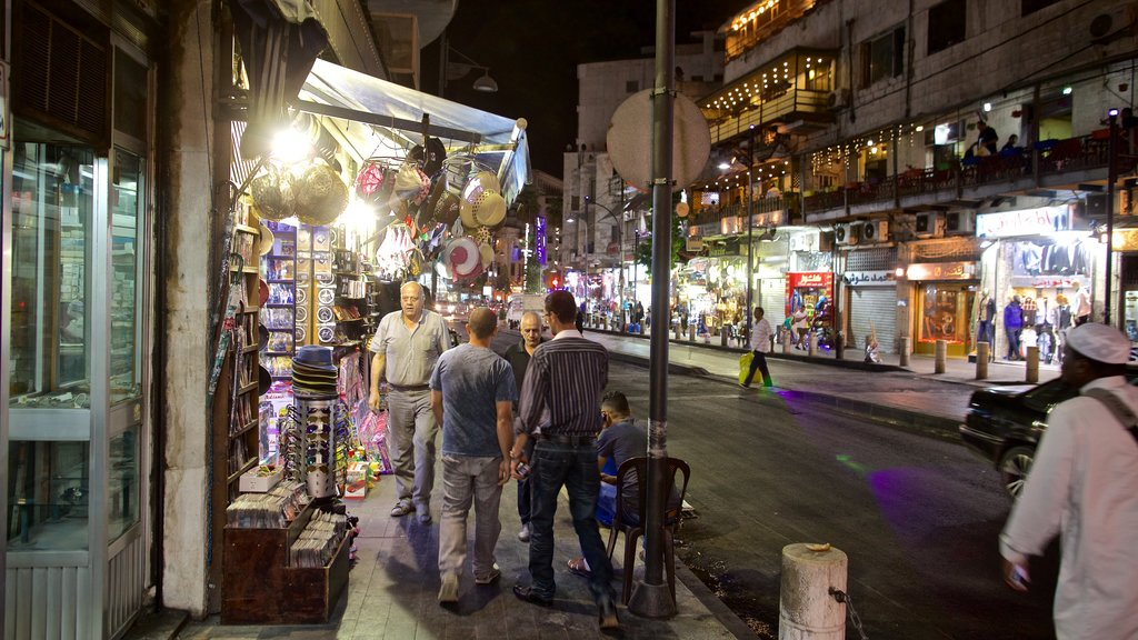 Amman showing night scenes and street scenes as well as a small group of people