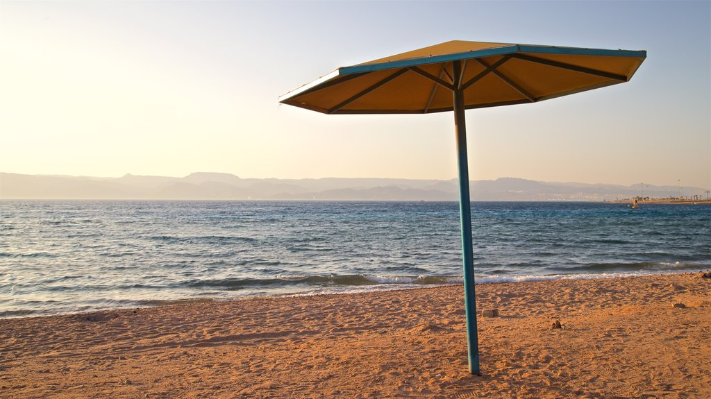Aqaba which includes a sunset, general coastal views and a beach