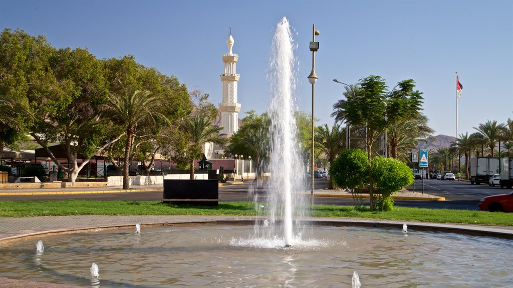 Aqaba which includes a fountain and heritage elements