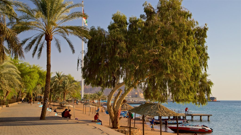 Aqaba which includes a beach and general coastal views as well as a small group of people