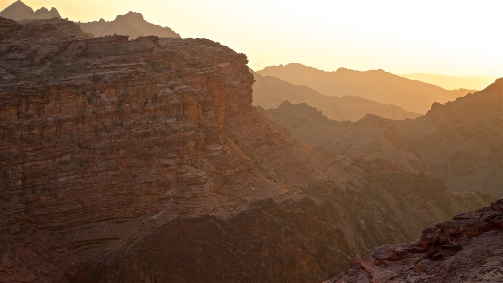Petra which includes a gorge or canyon, landscape views and a sunset