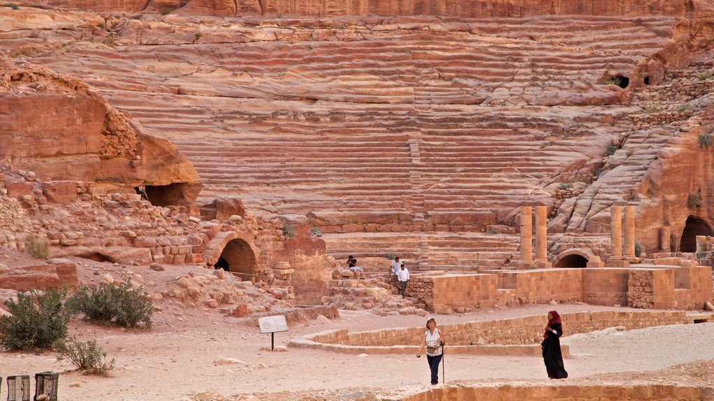 Nabatean Theater showing heritage elements and building ruins as well as a small group of people
