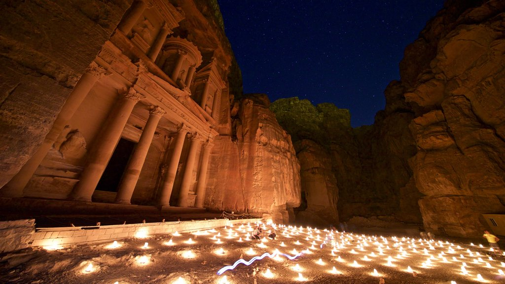 Wadi Musa showing night scenes, heritage architecture and a gorge or canyon