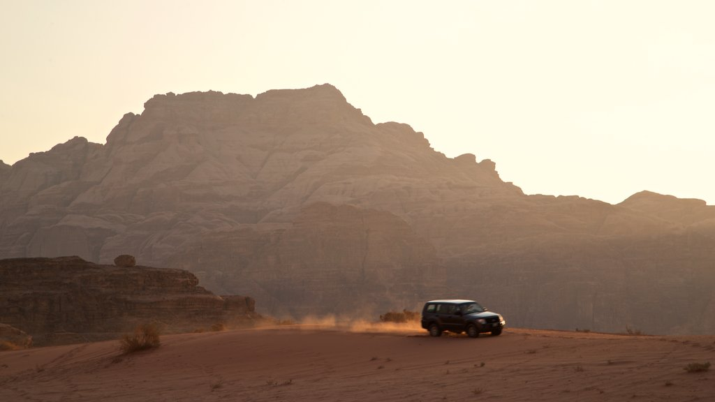 Wadi Rum showing a gorge or canyon, a sunset and desert views
