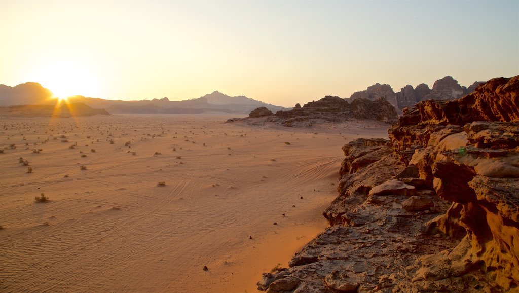 Wadi Rum which includes landscape views, a gorge or canyon and a sunset