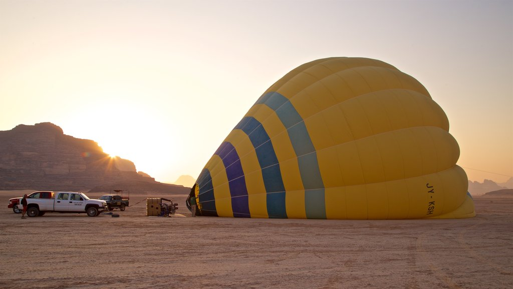 Wadi Rum which includes ballooning, a sunset and desert views