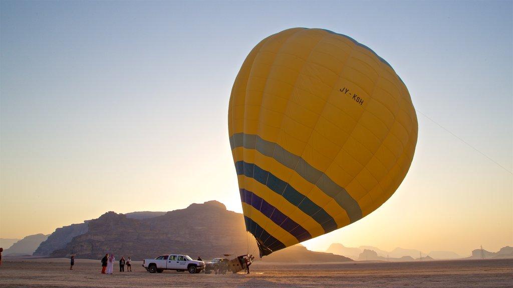 Wadi Rum featuring desert views, a sunset and ballooning