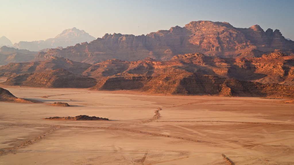 Wadi Rum featuring a sunset, a gorge or canyon and desert views