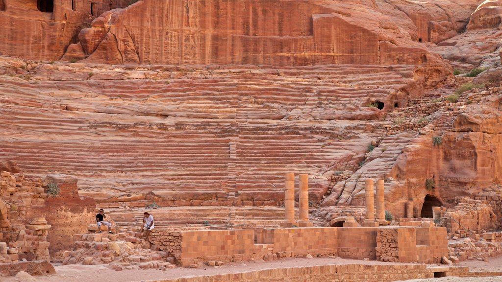 Nabatean Theater showing a gorge or canyon, heritage elements and building ruins