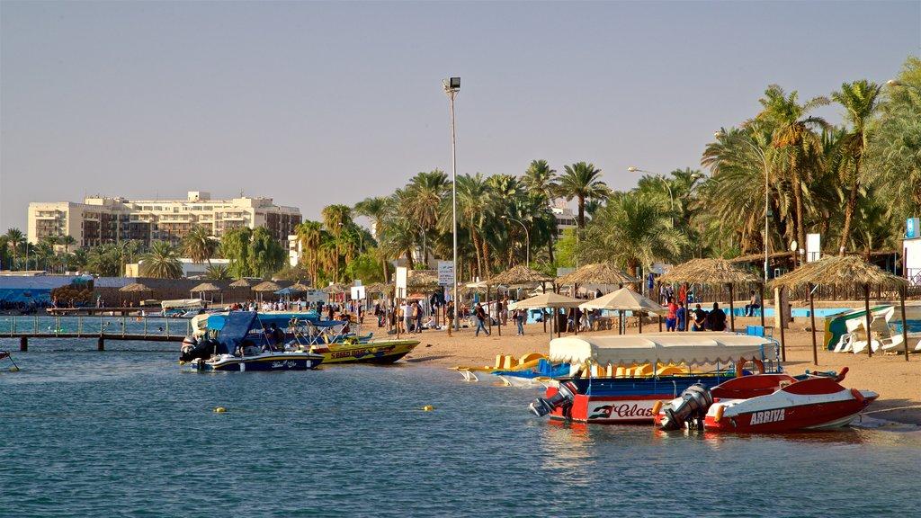 Aqaba which includes tropical scenes, general coastal views and a sandy beach