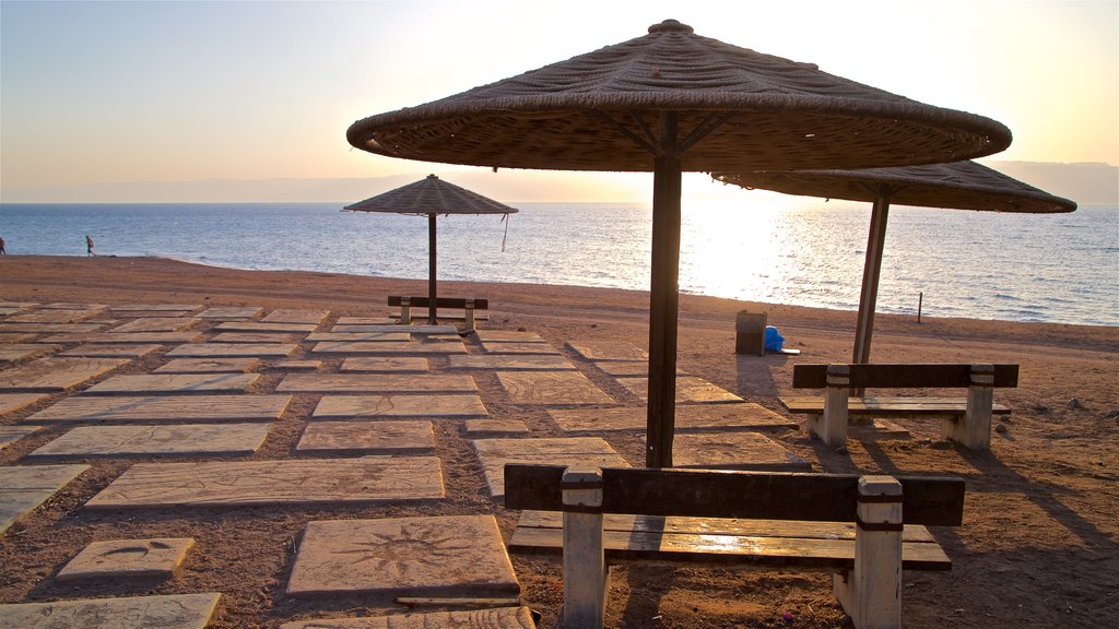 Aqaba featuring general coastal views, a sunset and a sandy beach
