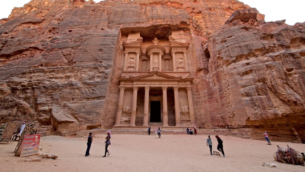 Wadi Musa which includes a gorge or canyon and heritage architecture as well as a small group of people
