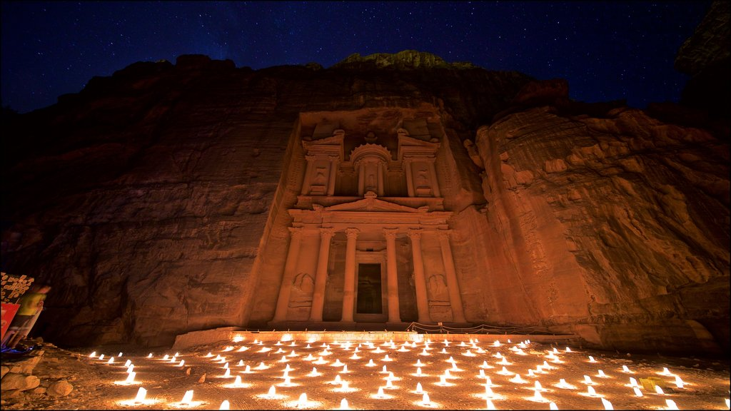 Wadi Musa which includes night scenes, heritage architecture and a gorge or canyon