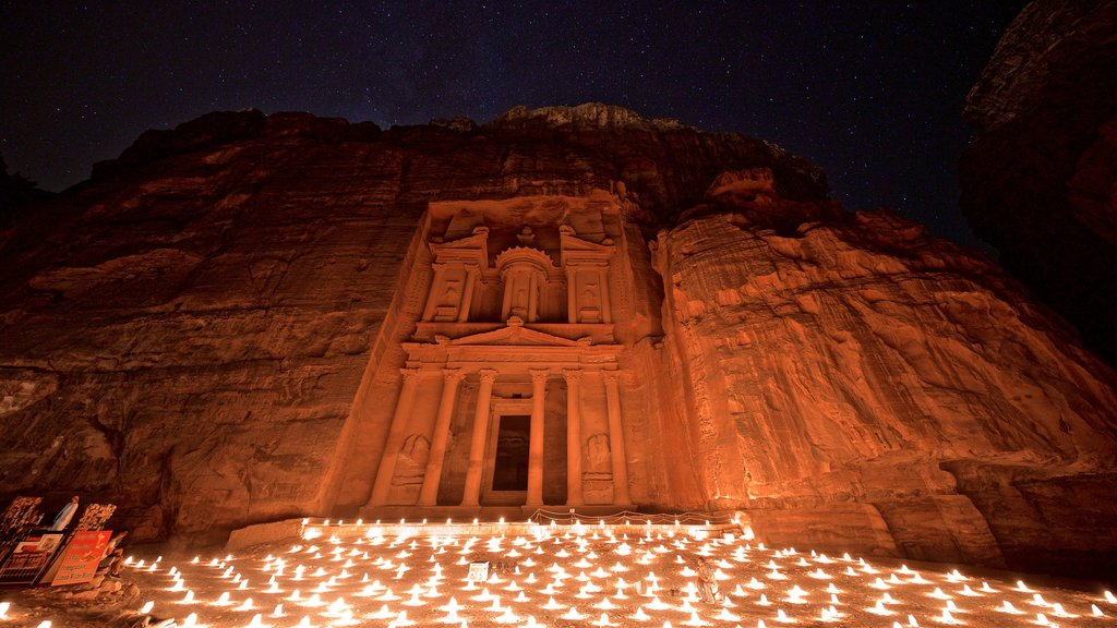 Wadi Musa showing heritage architecture, a gorge or canyon and night scenes