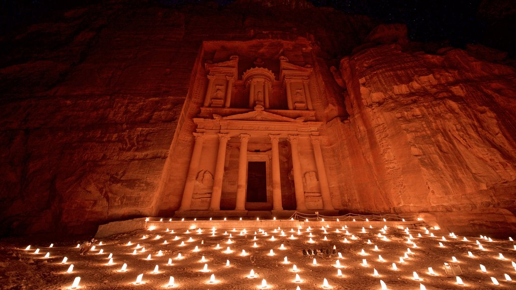 Wadi Musa which includes a gorge or canyon, night scenes and heritage architecture
