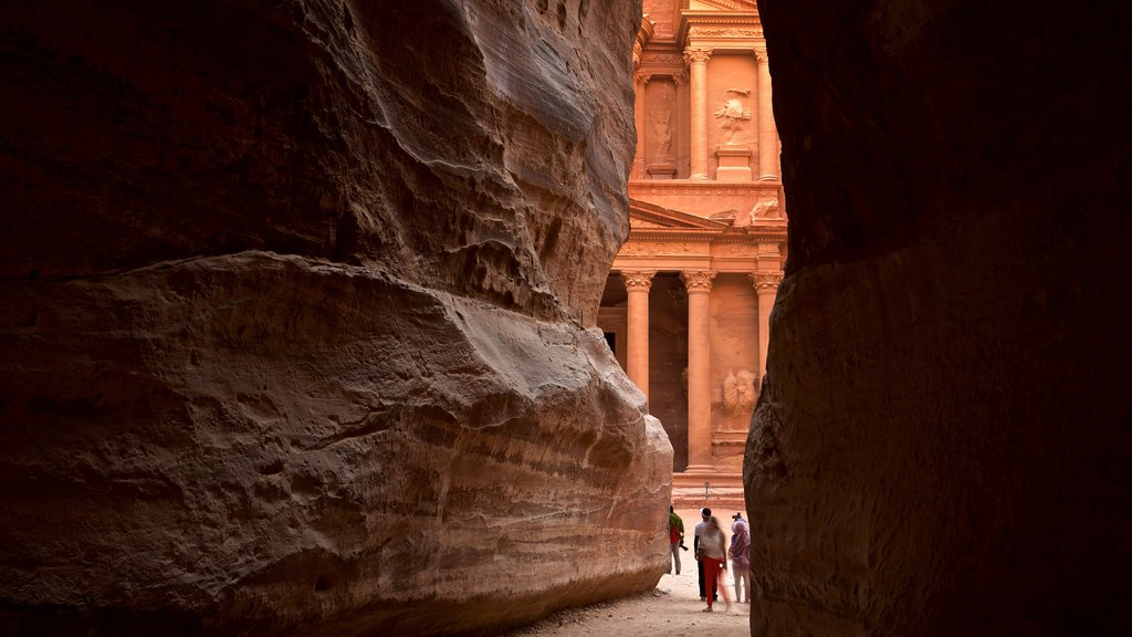 Wadi Musa featuring heritage elements and a gorge or canyon as well as a small group of people