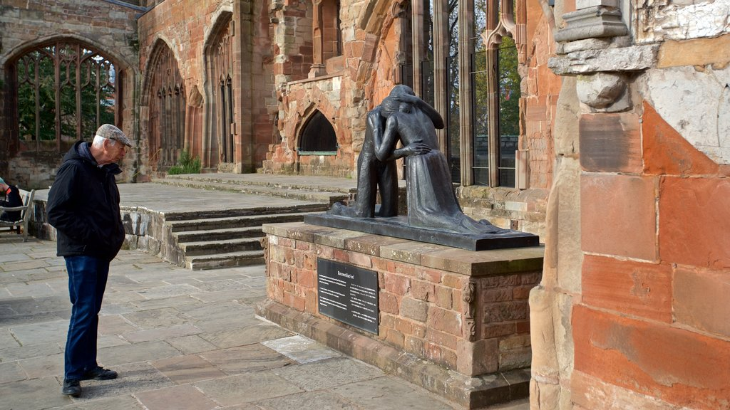 Coventry which includes street scenes and a statue or sculpture as well as an individual male