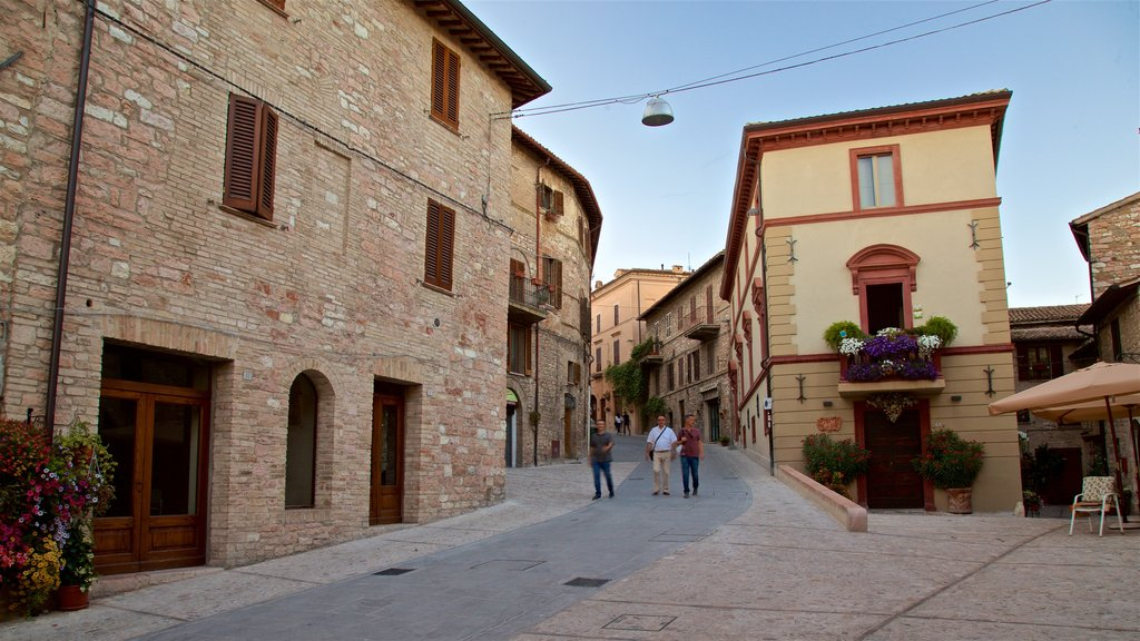 Spello featuring street scenes as well as a small group of people