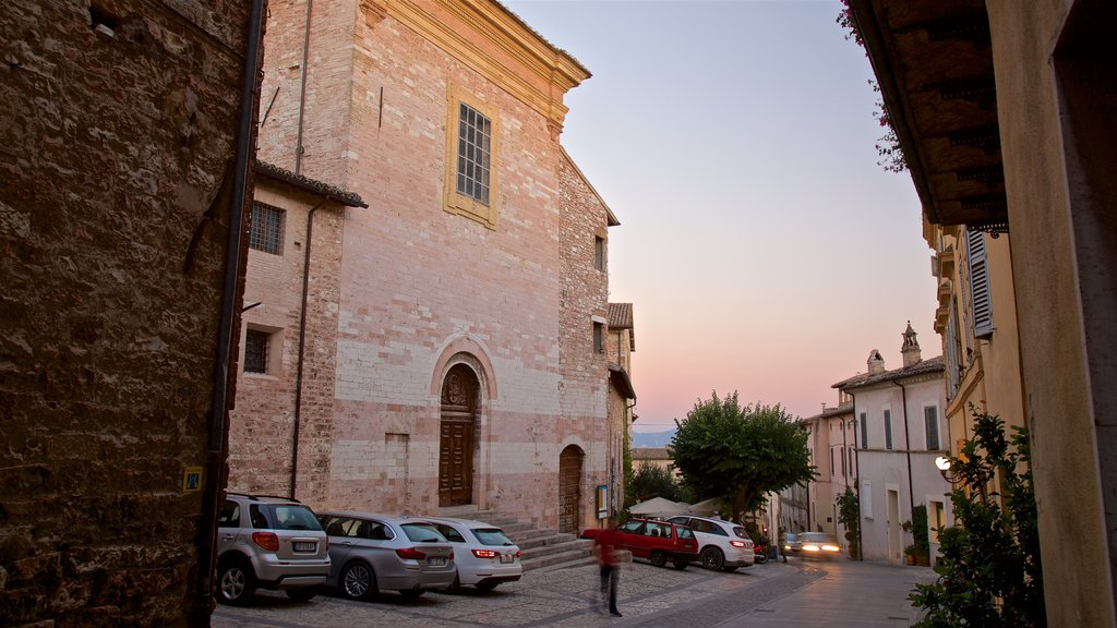 Spello showing heritage architecture and a sunset