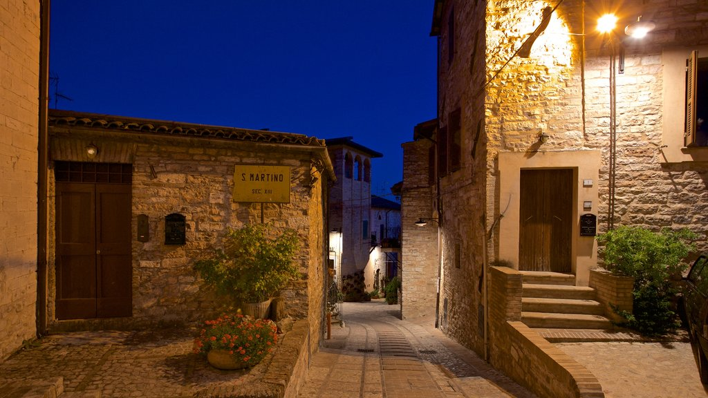 Spello featuring night scenes and a small town or village