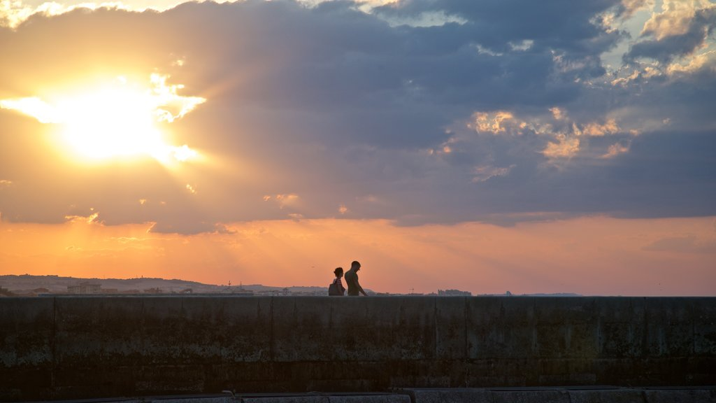 Senigallia which includes a sunset and landscape views as well as a couple
