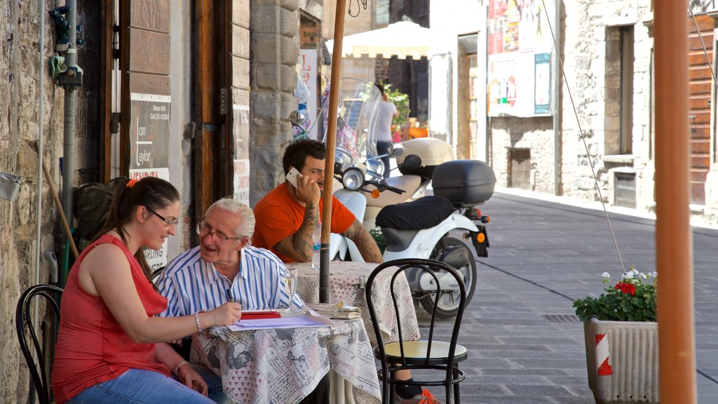 Gubbio featuring street scenes as well as a small group of people