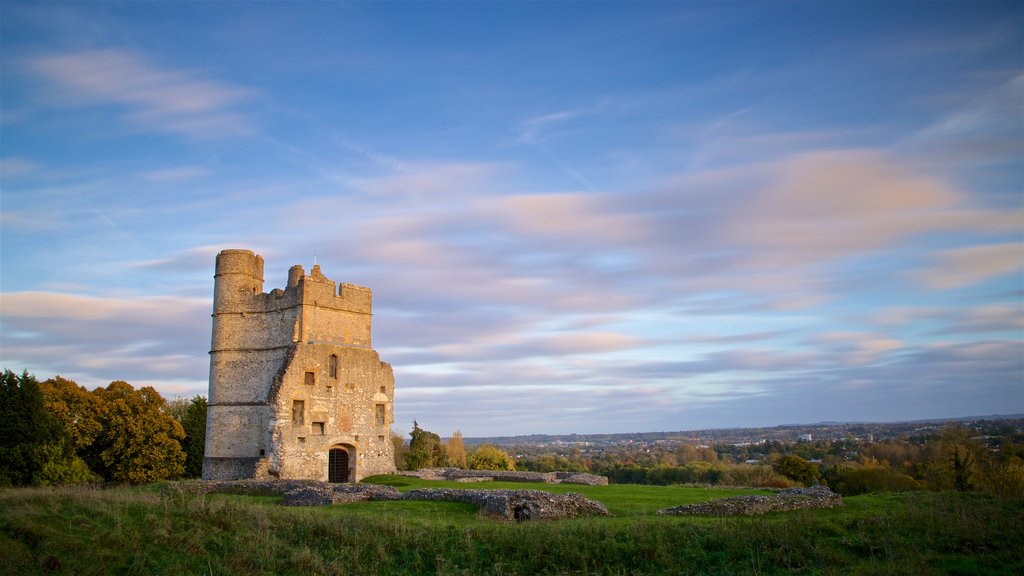 Donnington Castle which includes heritage architecture, a sunset and landscape views