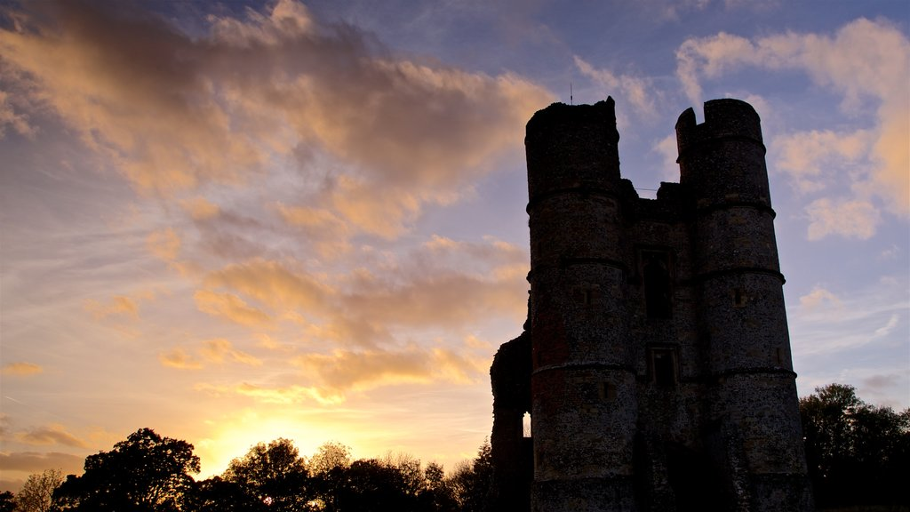Donnington Castle featuring a sunset and heritage architecture