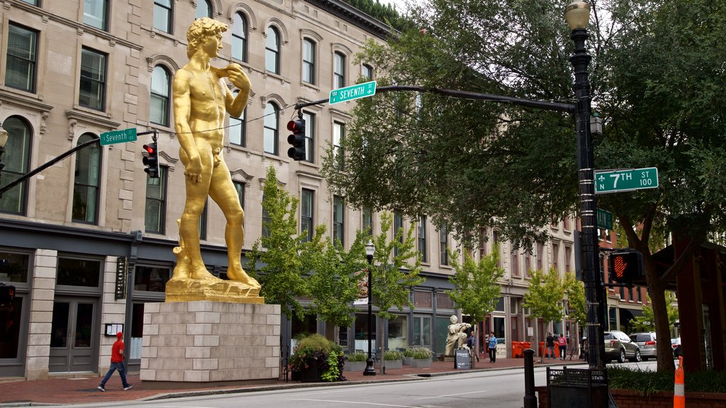 Louisville which includes a statue or sculpture, a city and outdoor art