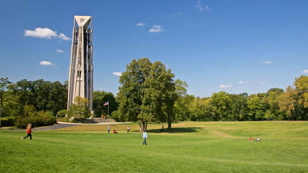 Moser Tower and Millennium Carillon showing a garden as well as a small group of people