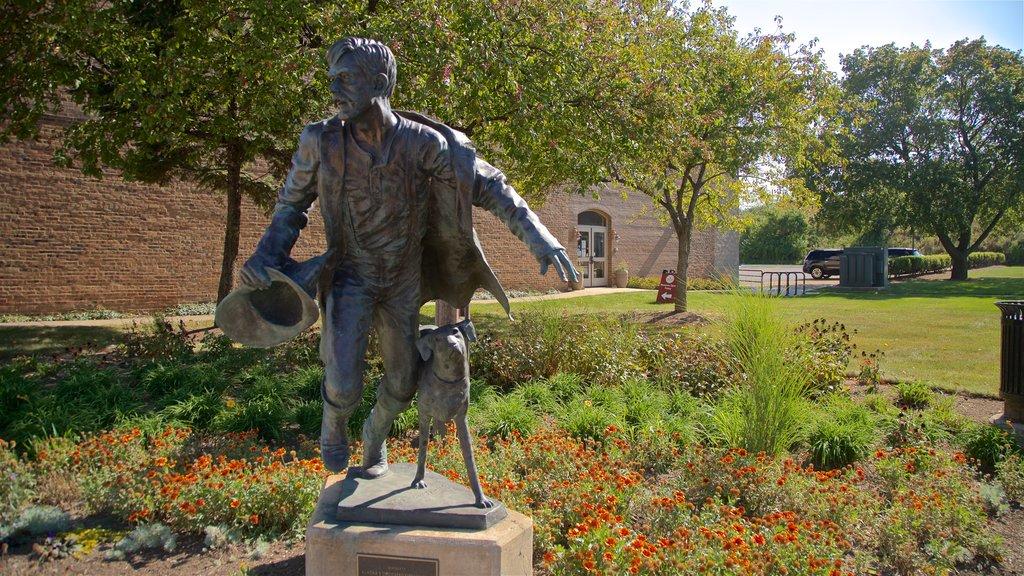 Aurora Regional Fire Museum showing a statue or sculpture and a garden