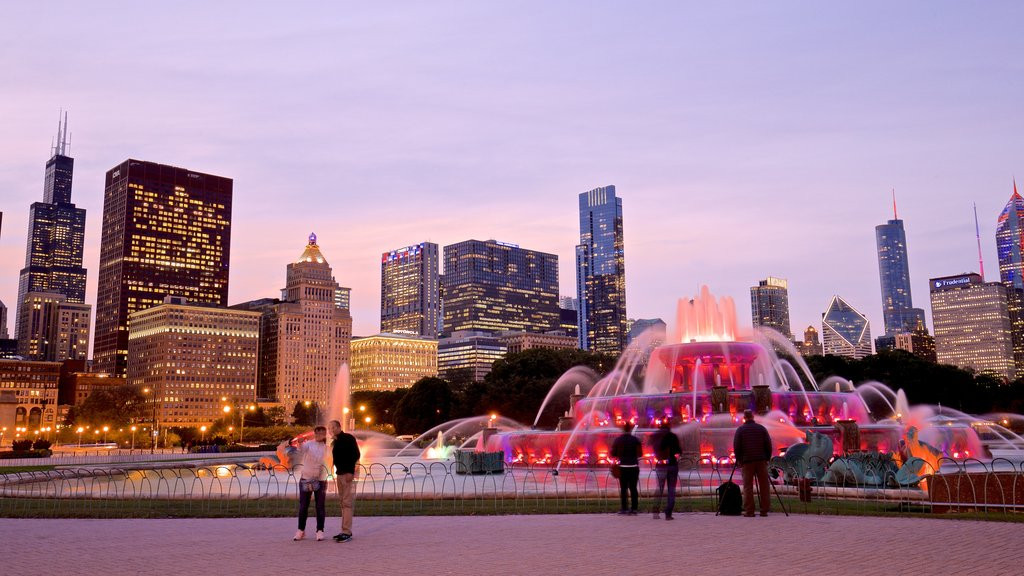 Buckingham Fountain which includes a city, a fountain and a high rise building