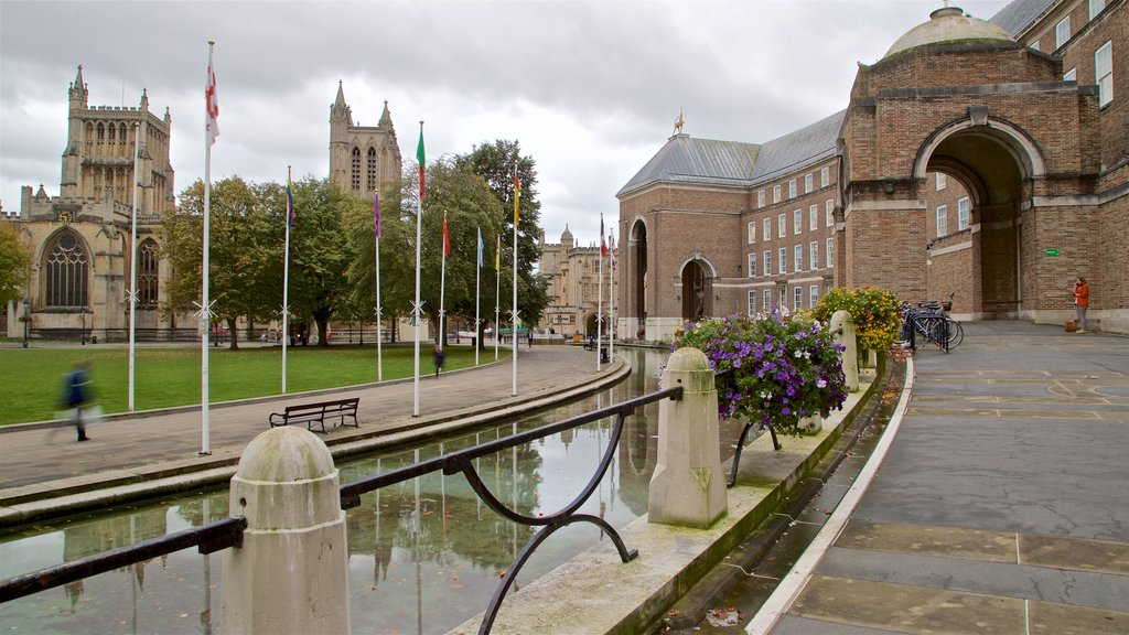Bristol Cathedral which includes heritage elements, flowers and a river or creek