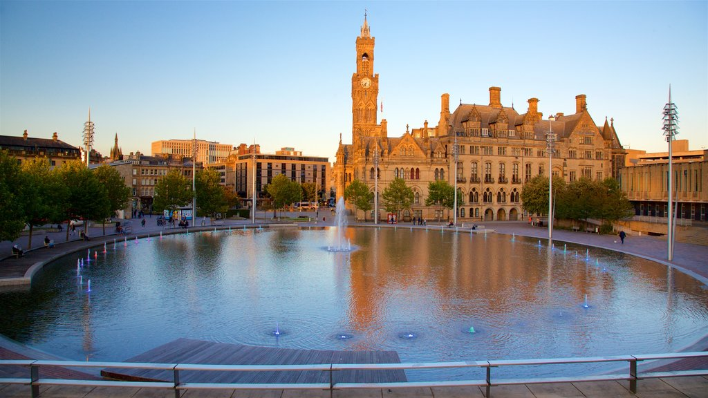Bradford City Hall which includes a fountain, heritage architecture and a sunset