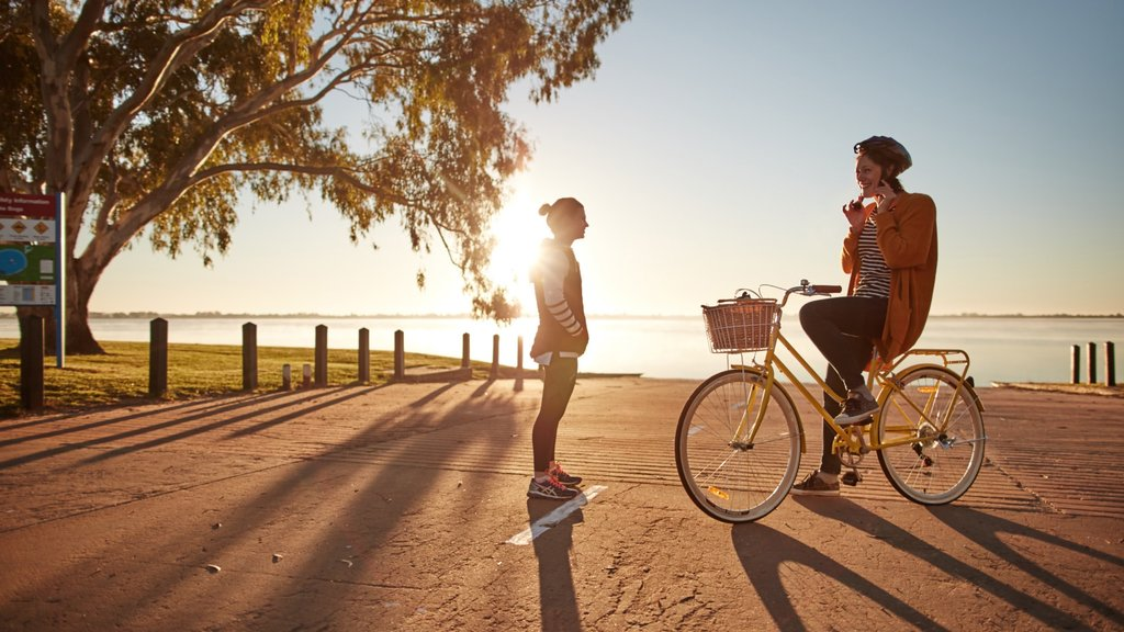 Swan Hill which includes a sunset and cycling as well as an individual child