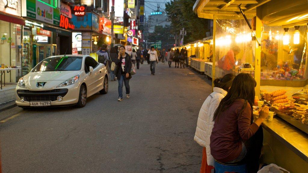 Hongdae showing a city, street scenes and food