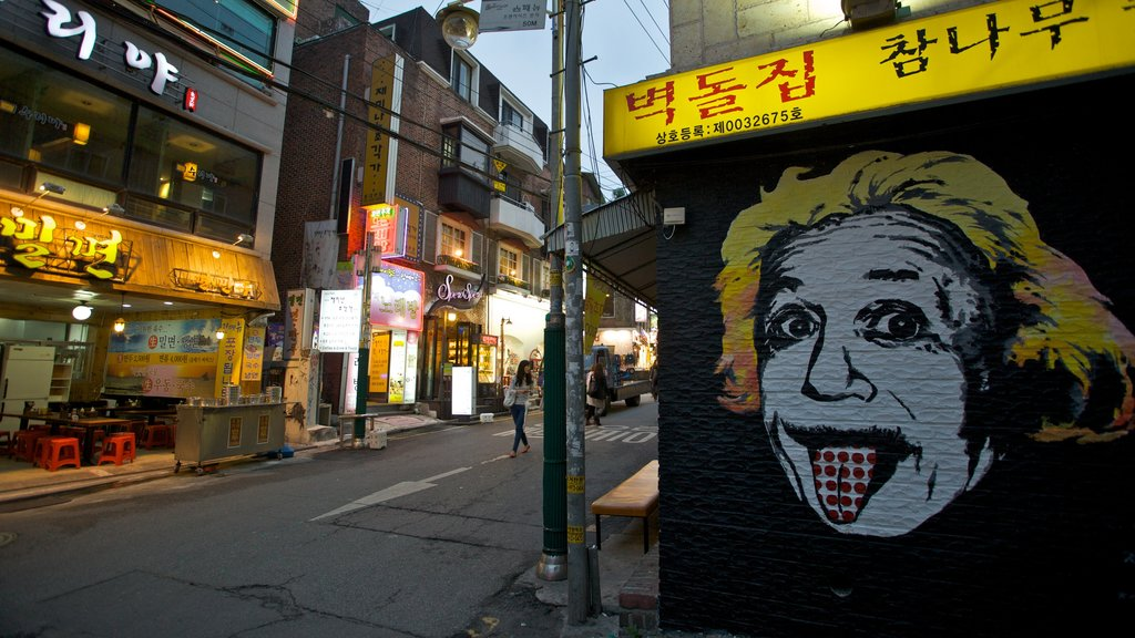 Hongdae which includes street scenes, outdoor art and signage