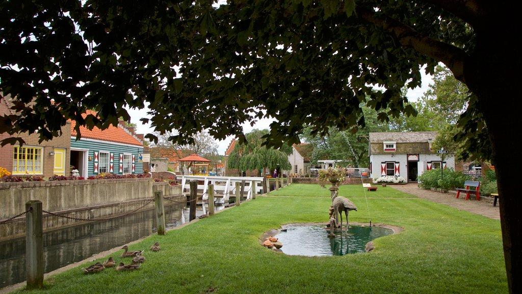 Dutch Village featuring a fountain, a garden and a river or creek