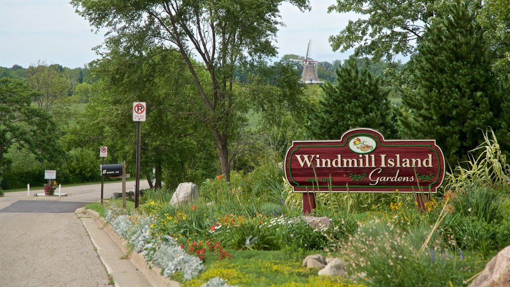 Windmill Island showing a garden, wildflowers and signage