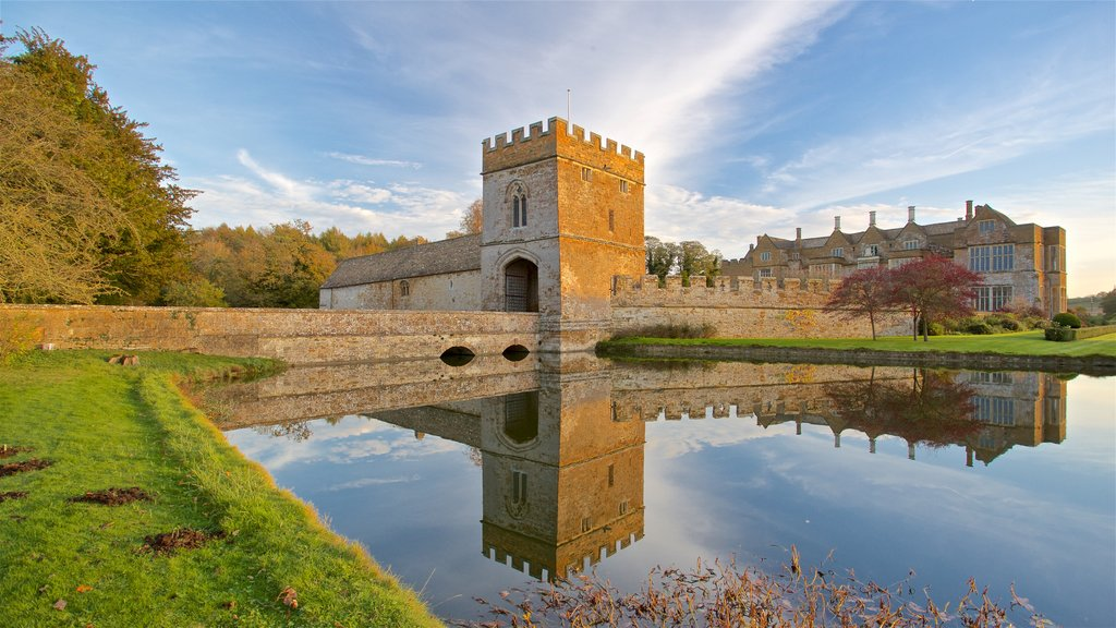Broughton Castle showing chateau or palace, heritage architecture and a sunset